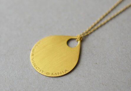 Necklace amor vincit omnia