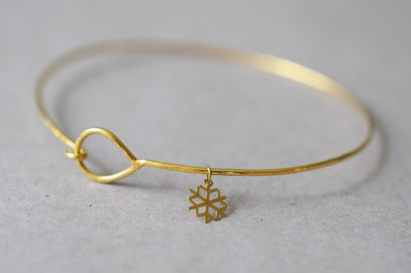 Fine Hammered Bangle with tiny Snowflake